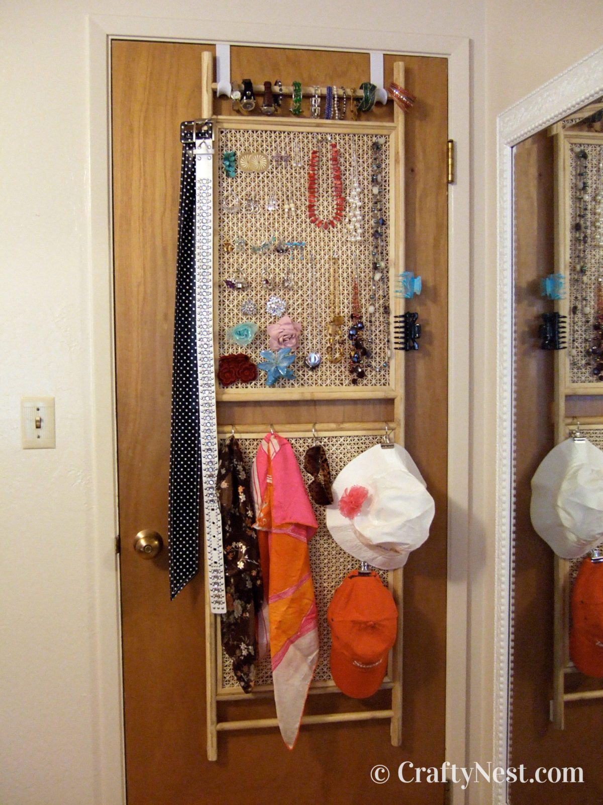 Fashion accessories organizer hanging on the back of a door, photo