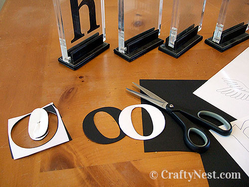 Cutting out the letters, photo