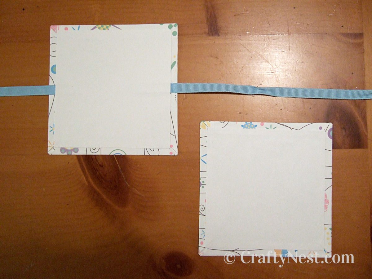 Glue ribbon onto book cover, photo
