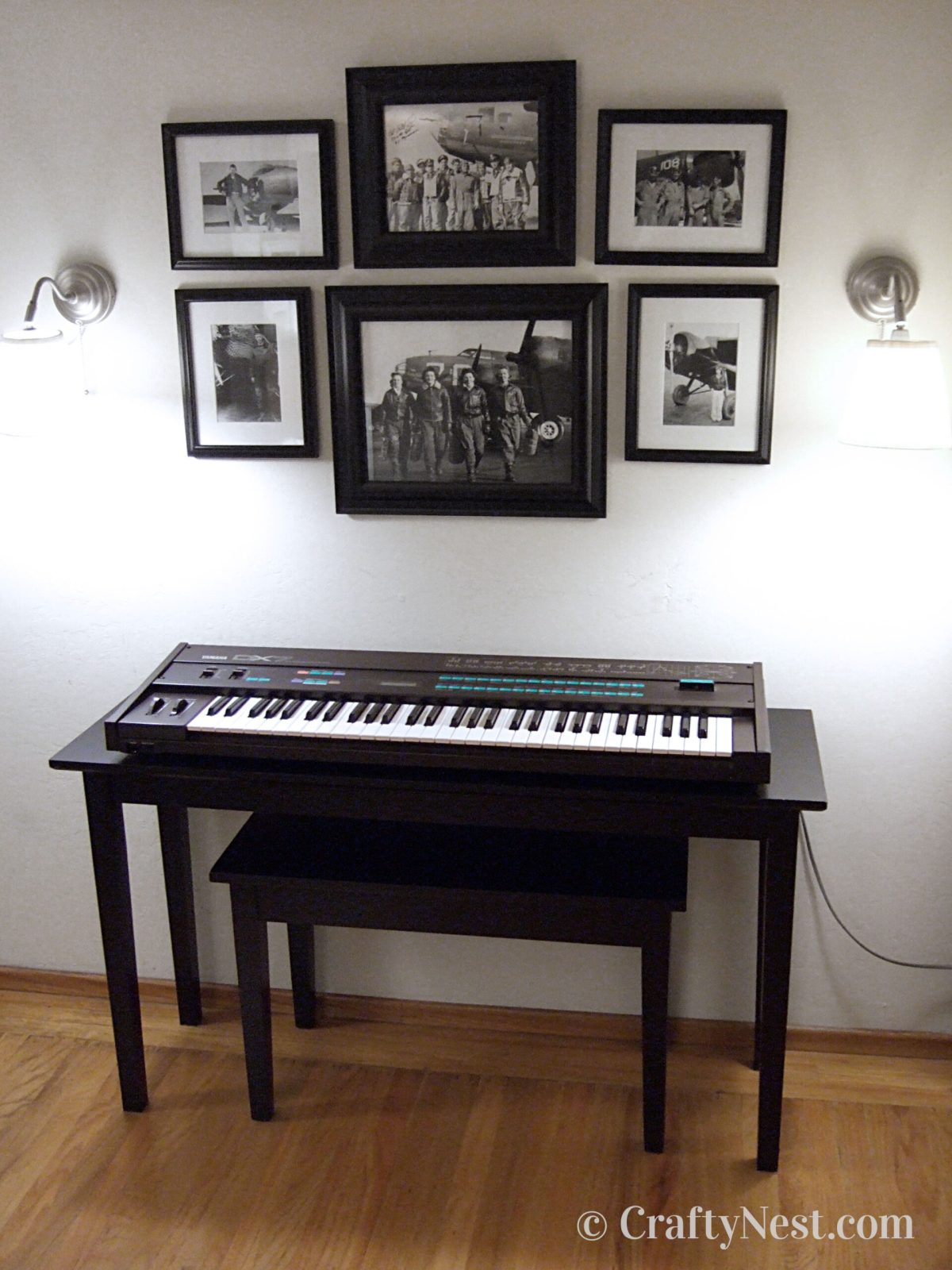Black piano keyboard table and bench, photo