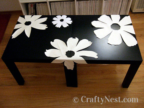 Tape all flowers to tables, photo