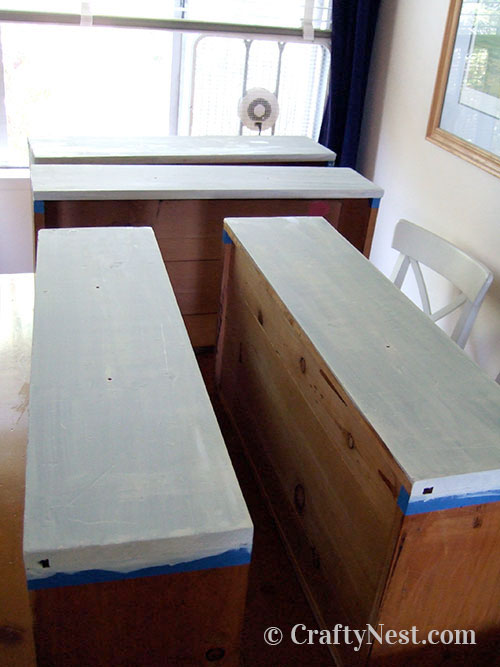 Painters tape and primer on drawers, photo
