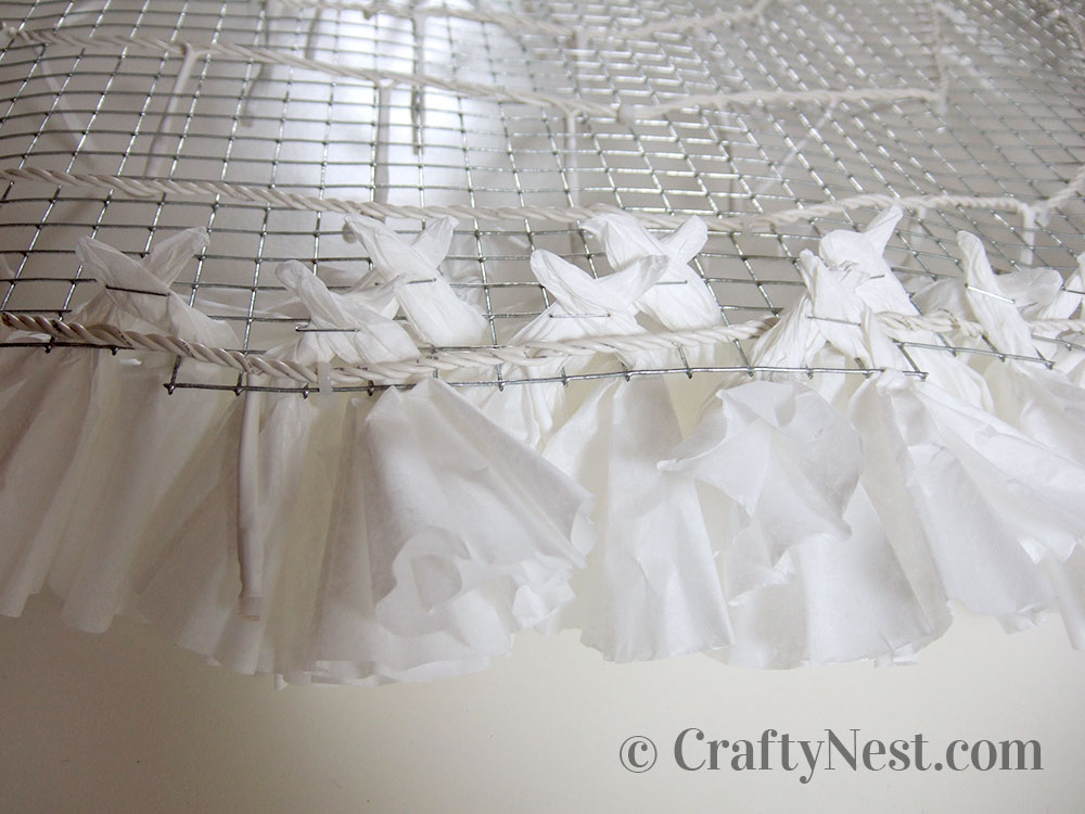 Coffee filters stapled together through mesh, photo