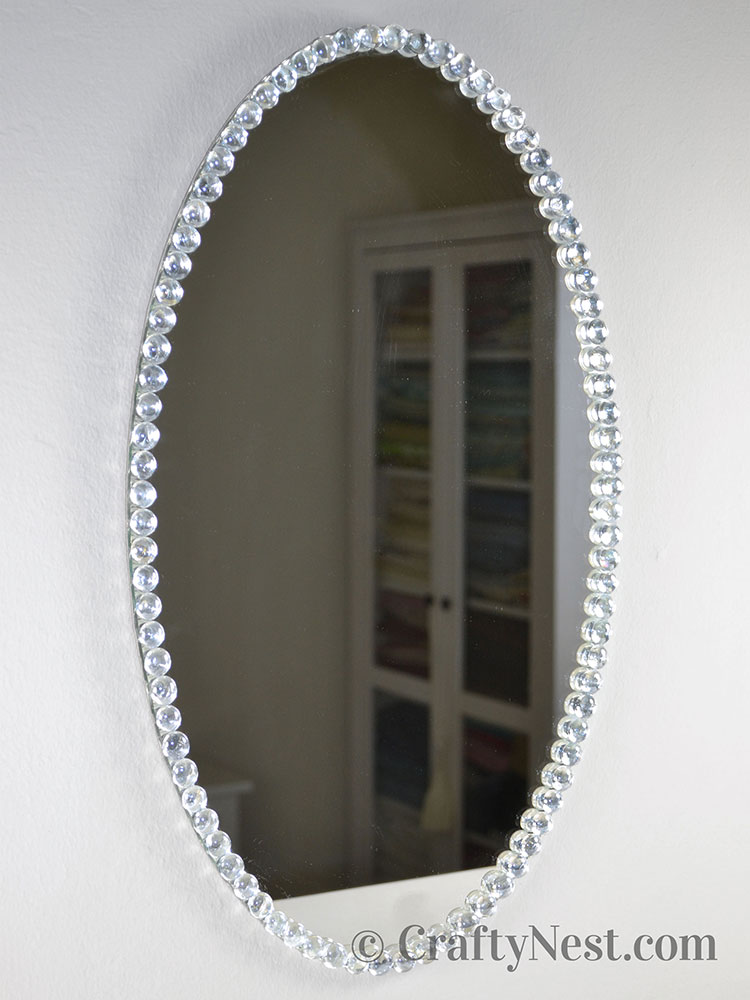 Finished mirror hung on the wall, photo
