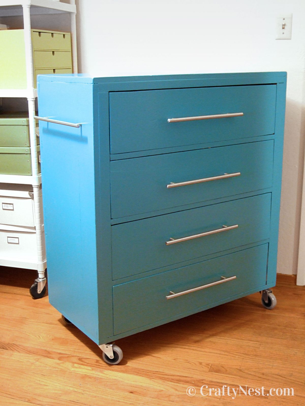 A chest of drawers painted blue, photo