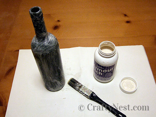 Remove etching cream with paint brush, photo