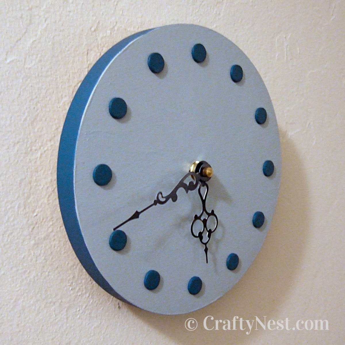 Side view of small clock, photo