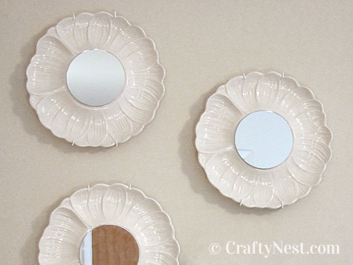 Three artichoke plates with mirrors, photo