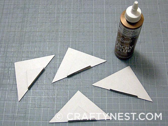 Glue cardboard triangles together, photo