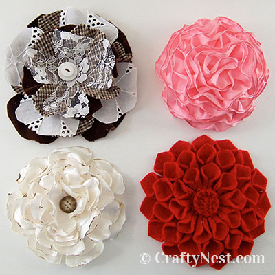 Four fabric flower brooches, photo