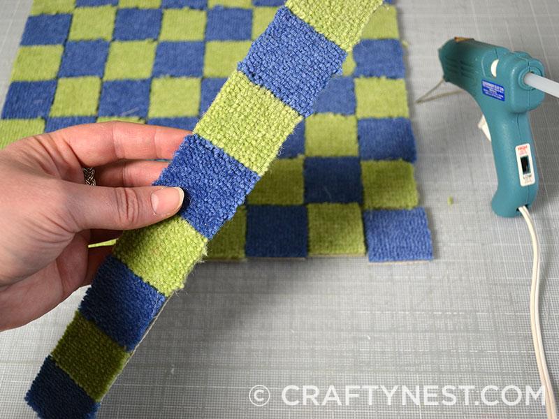 Glue carpet squares into strips, photo