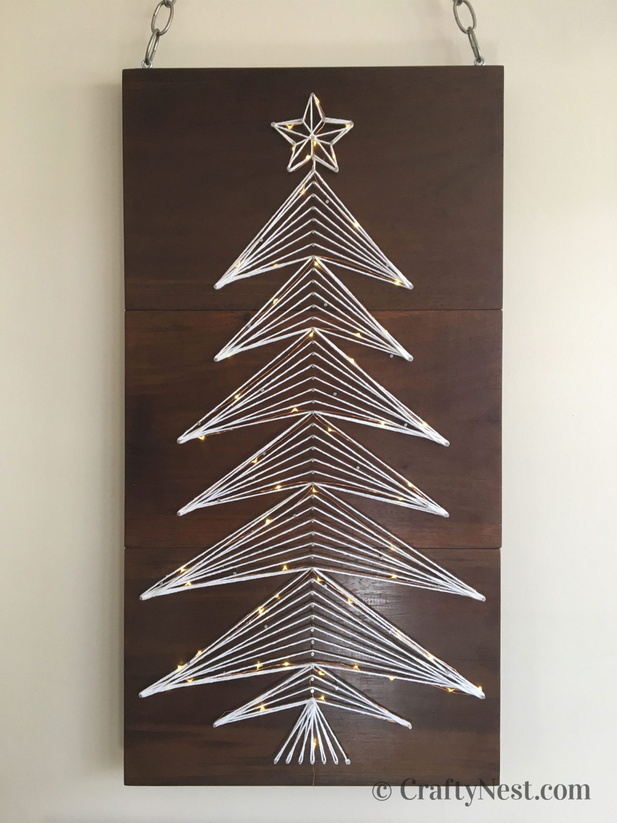 String-art Christmas tree with lights, photo