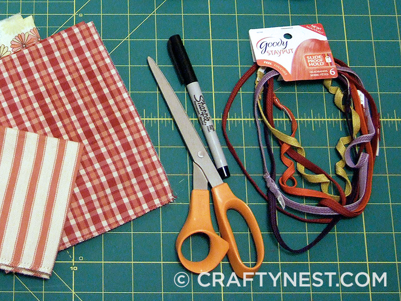 Supplies and tools to make fabric flower headbands, photo