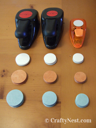 Punched circles in stacks next to hole punches, photo