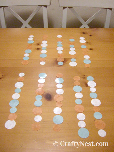 Lay the circles in alternating patterned strands, photo
