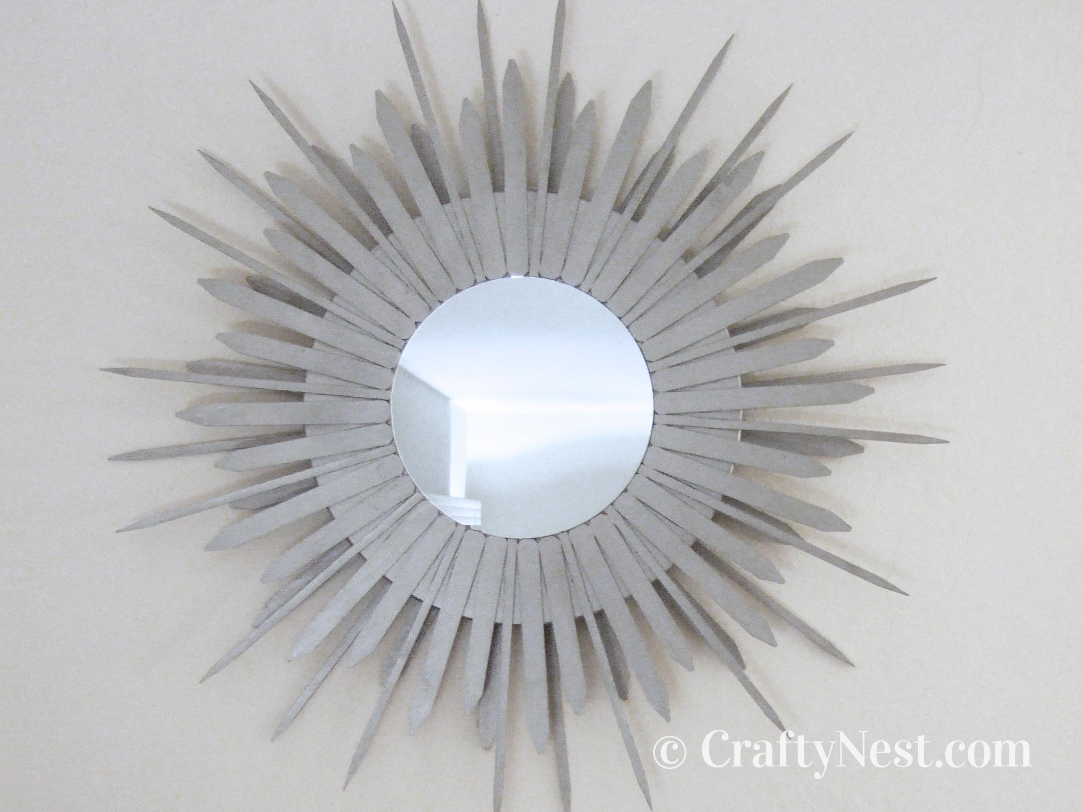 DIY starburst mirror on the wall, photo