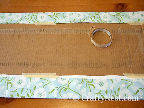 Tape the fabric around the cardboard, photo