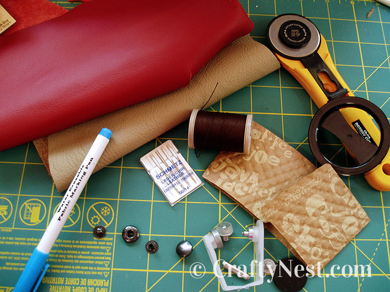 Supplies and tools to make a leather coffee sleeve, photo