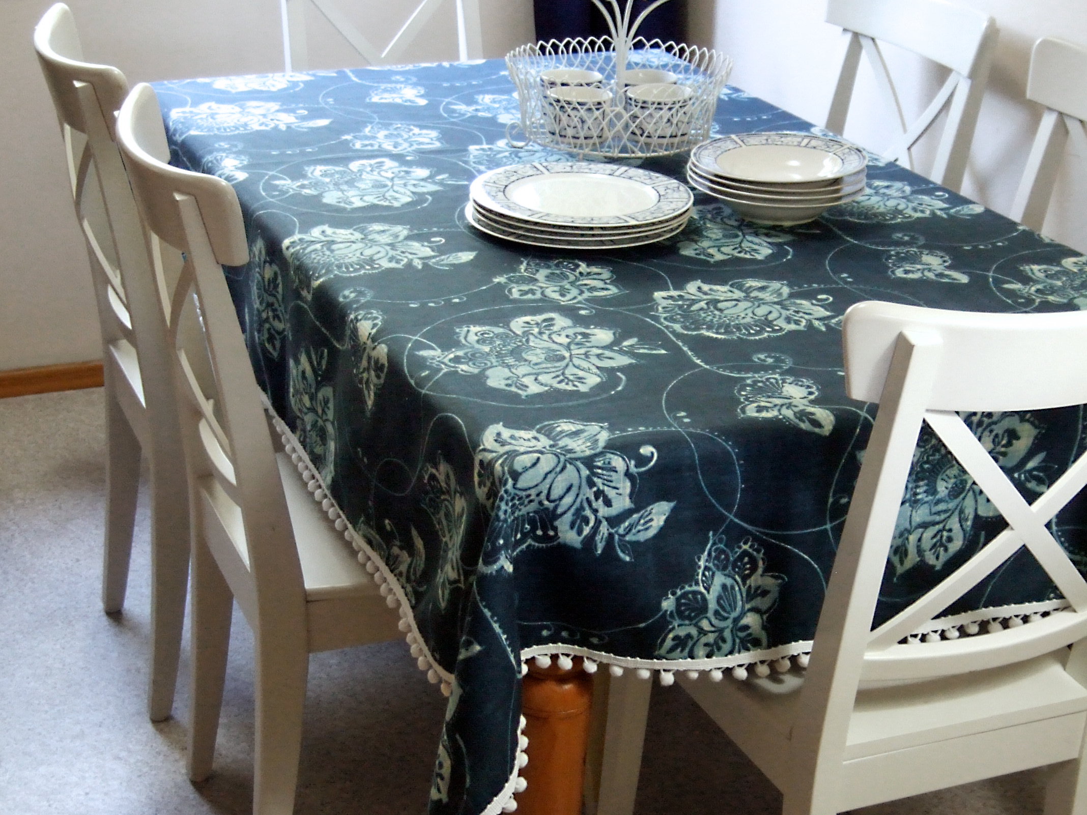 Blue and white floral tablecloth. photo