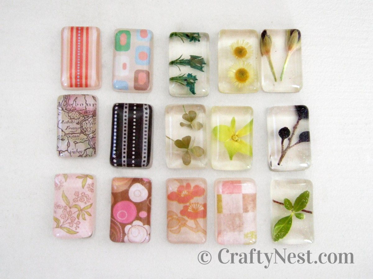 Fifteen different resin pendants before being drilled, photo