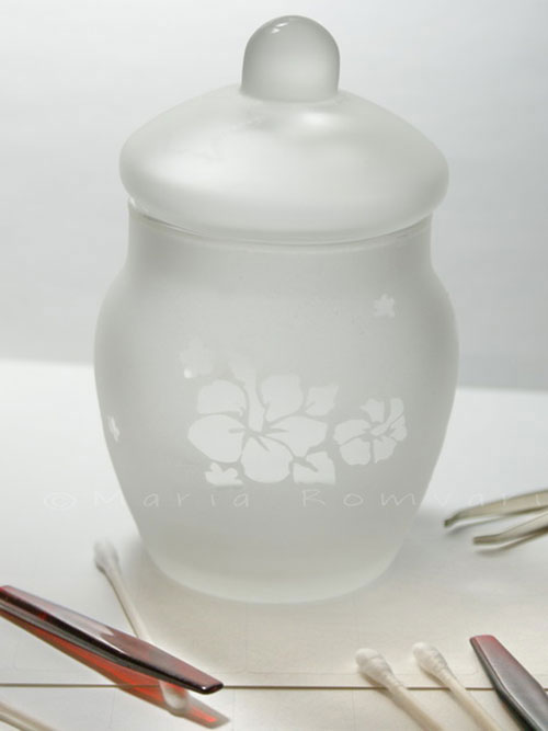 Frosted glass jar with flower pattern, photo