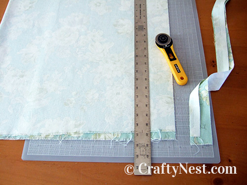 Cutting fabric with rotary cutter, photo