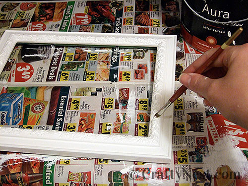 Painting the picture frame, photo