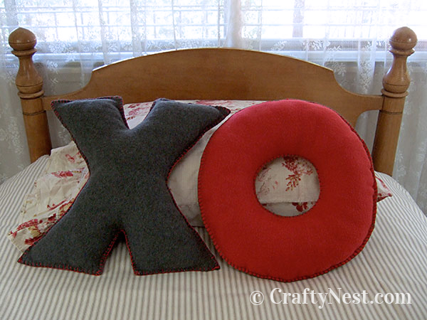 Fleece XO pillows on a bed, photo