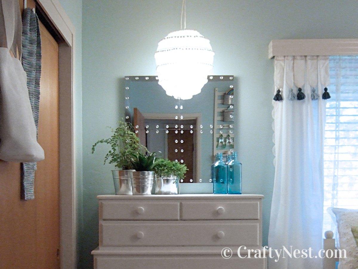 Paper lantern pendant above a dresser, photo