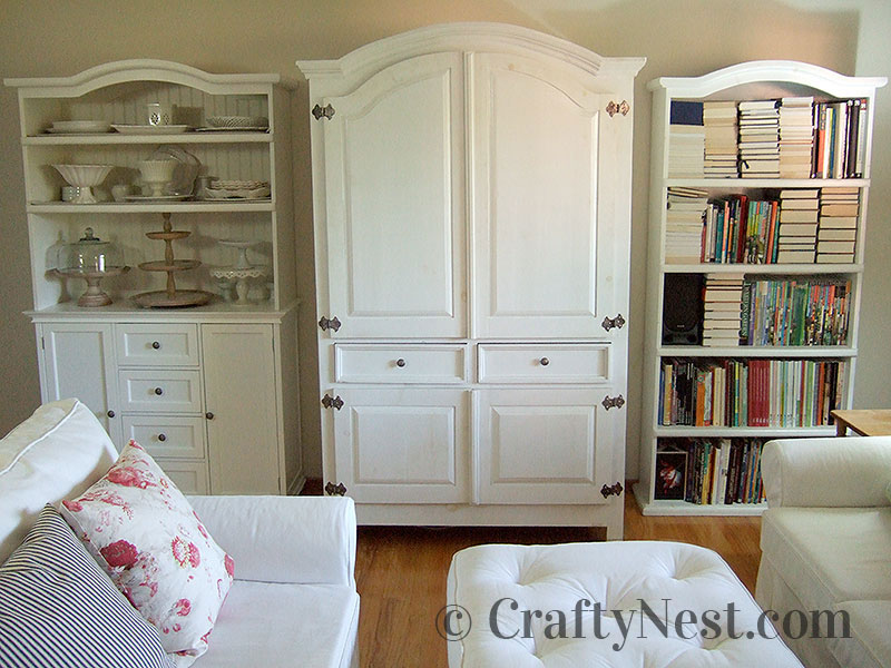 Living room with armoire, china cabinet, and bookshelf, photo