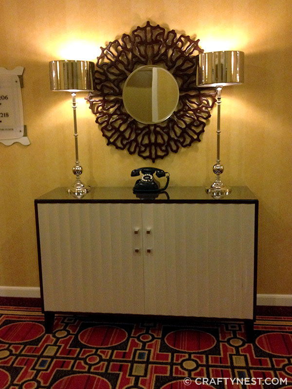 Credenza, mirror, phone, and lamps in hallway of Hotel Monaco, photo