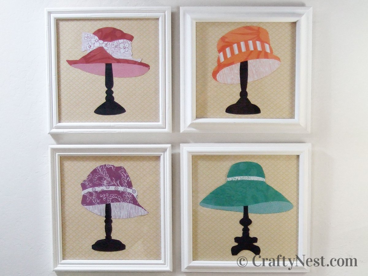 Paper hat silhouettes framed on the wall, photo