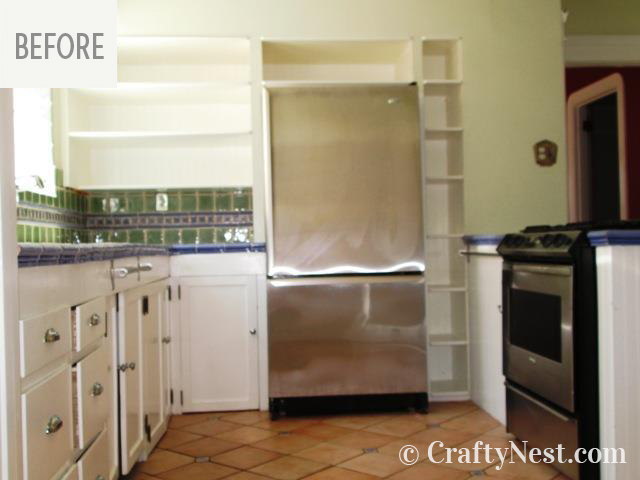 Kitchen with open shelves and fridge, photo