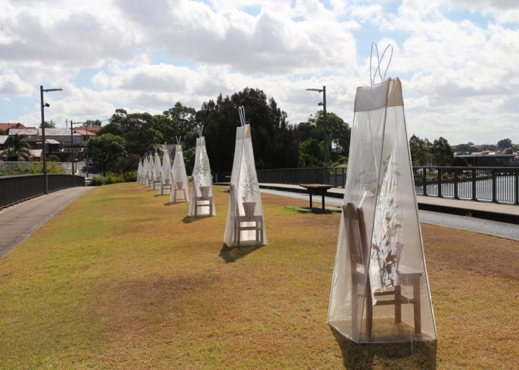 In The Bag: when is enough enough? transparent fabric, timber chairs, native trees, soil, plant pots (tissu transparent, chaises en bois, arbres, terre, plantes en pot), Old Lilyfield Road Bridge, Sydney, Australia © Sally Kidall 2016