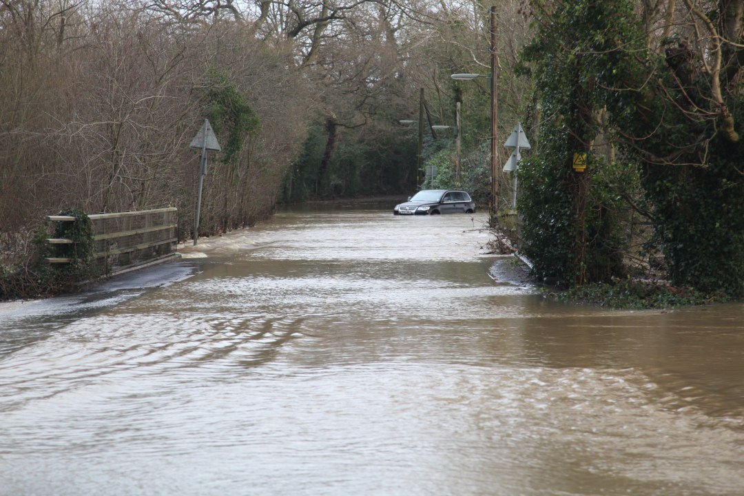 Car stuck in flood water Cranleigh 2013-14