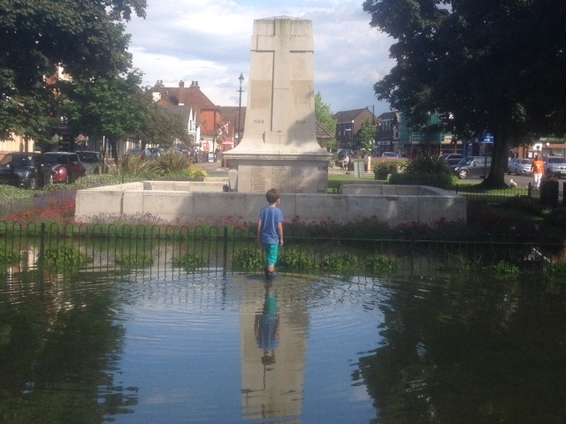 Child in flood water Cranleigh Memorial 25-06-16