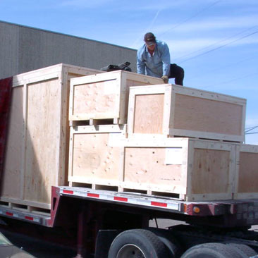 loading crates on truck