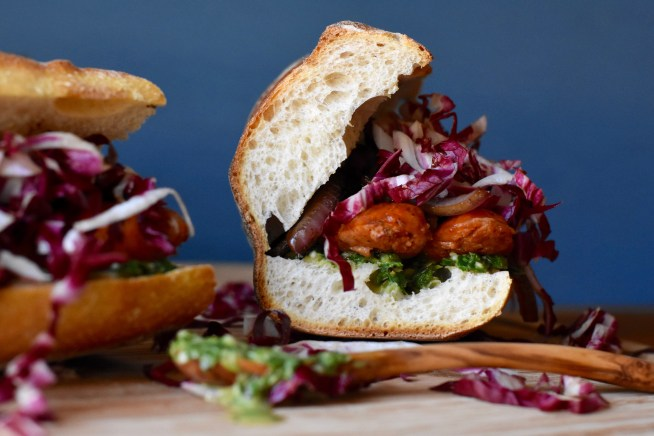 Sausage Sandwiches with Chimichurri, Caramelized Onions, and Radicchio
