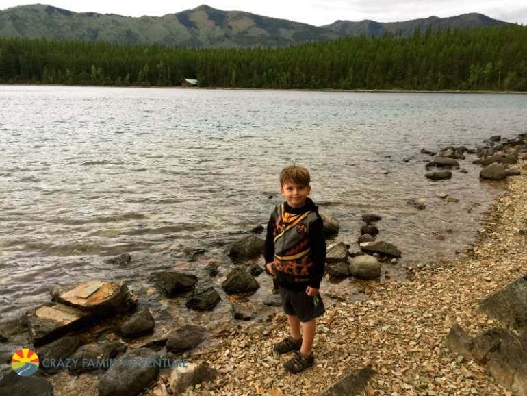 Knox skipping stones in Lake McDonald during our Rocky Point hike