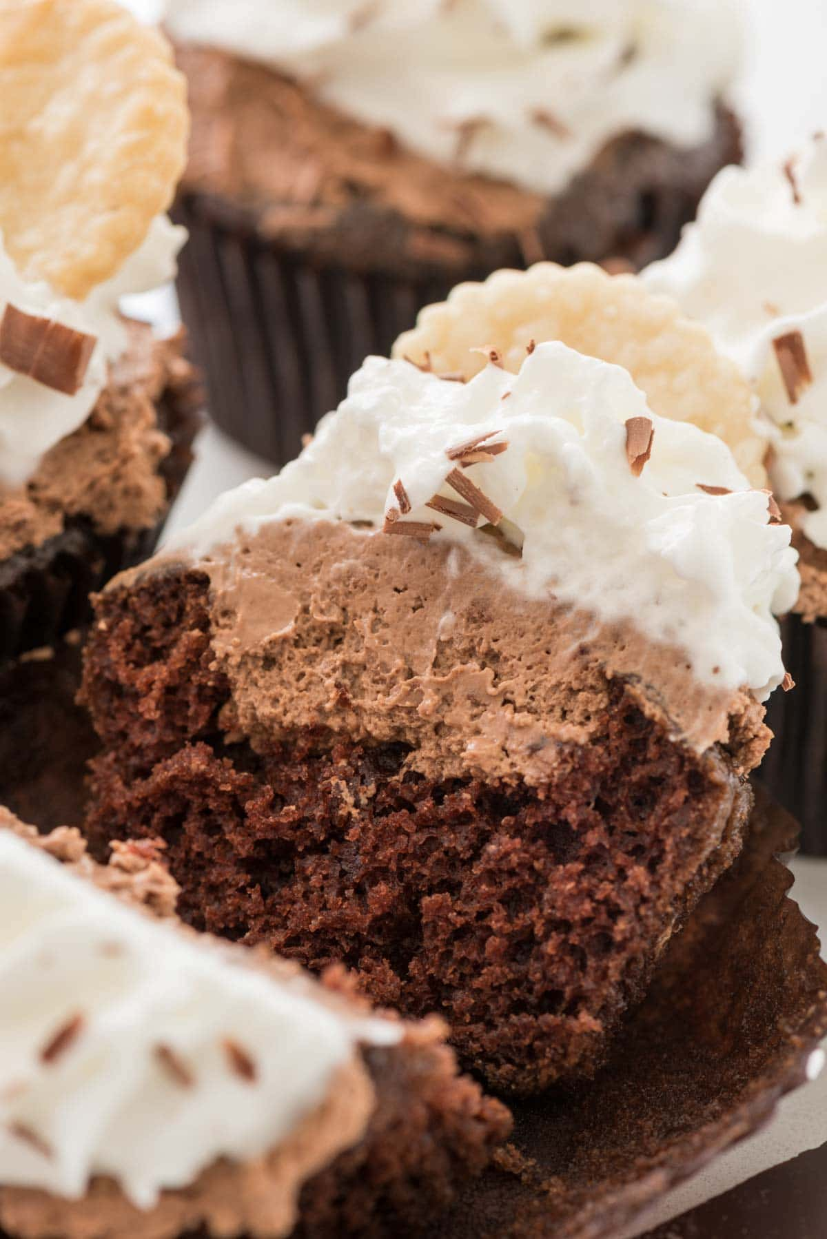 French Silk Cupcakes - these easy chocolate cupcakes are filled with an eggless french silk filling and topped with whipped cream!