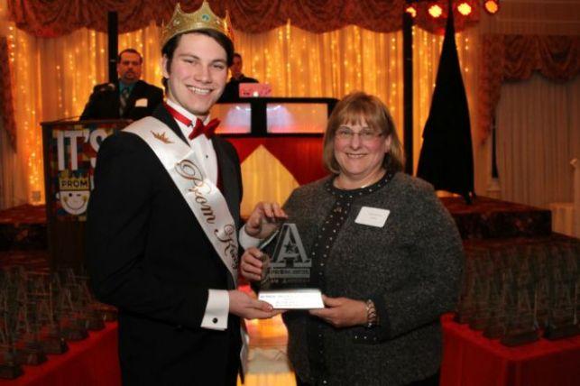 Diane accepting a 2015 Silver Addy Award for Creatacor