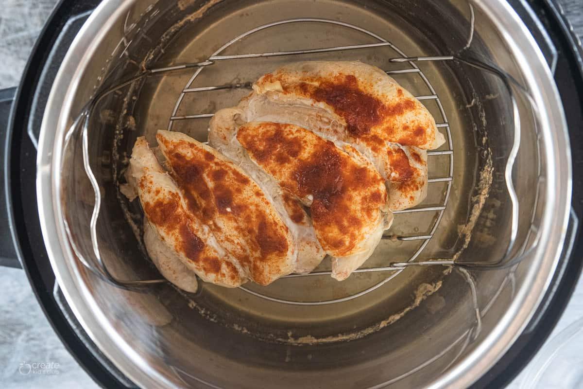 cooked chicken tenderloins in instant pot seasoned with taco seasoning