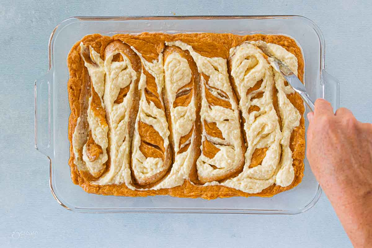 pumpkin bar batter swirled into pumpkin puree
