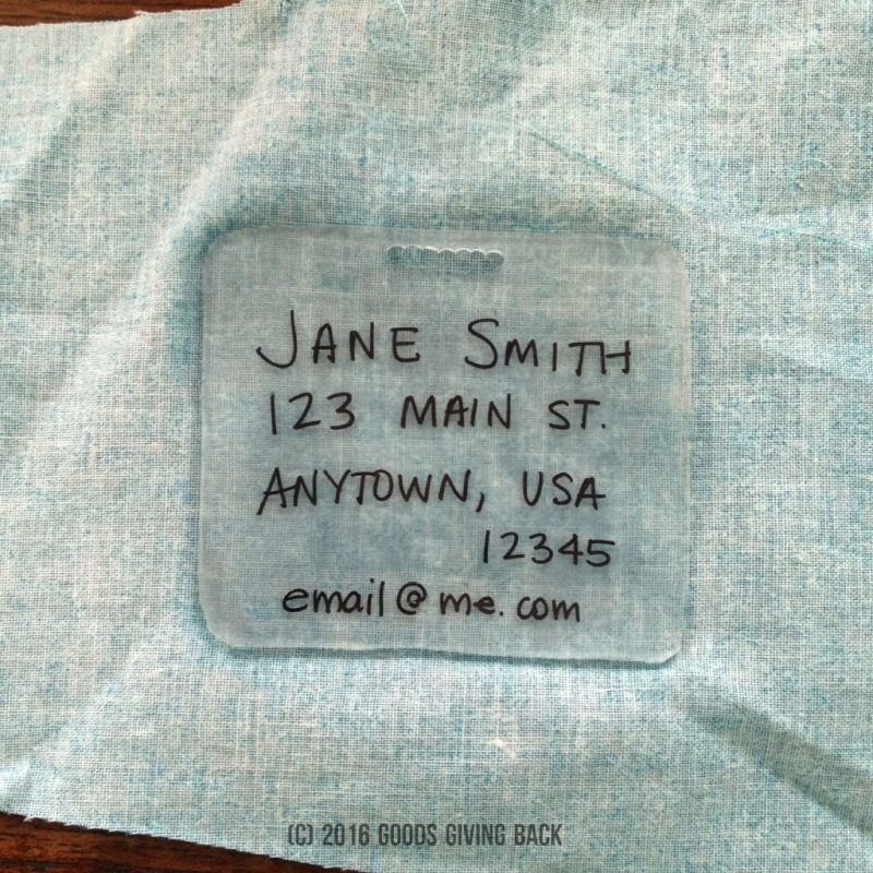 Glue plastic tag to fabric scrap