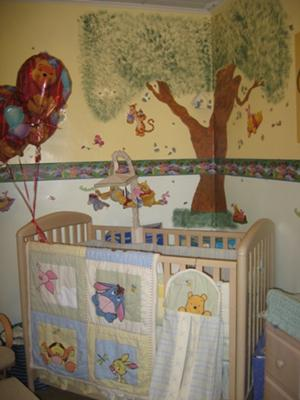 Crib area of the Winnie the Pooh and Friends Nursery under the tree