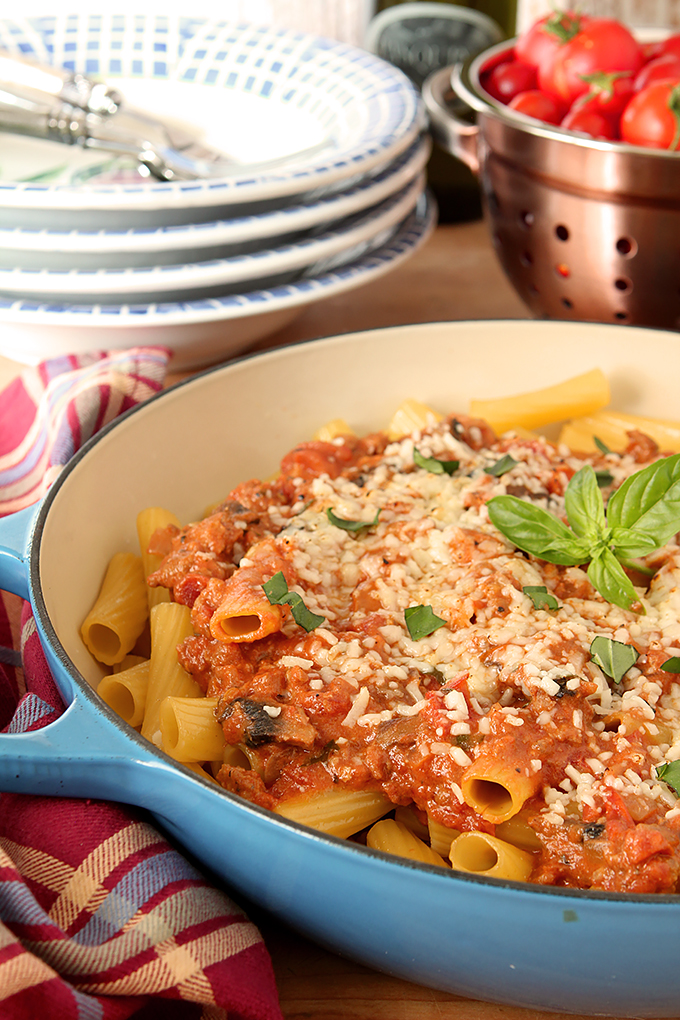 Roasted Tomato and Italian Sausage Pasta with Cream in Royal Blue Skillet