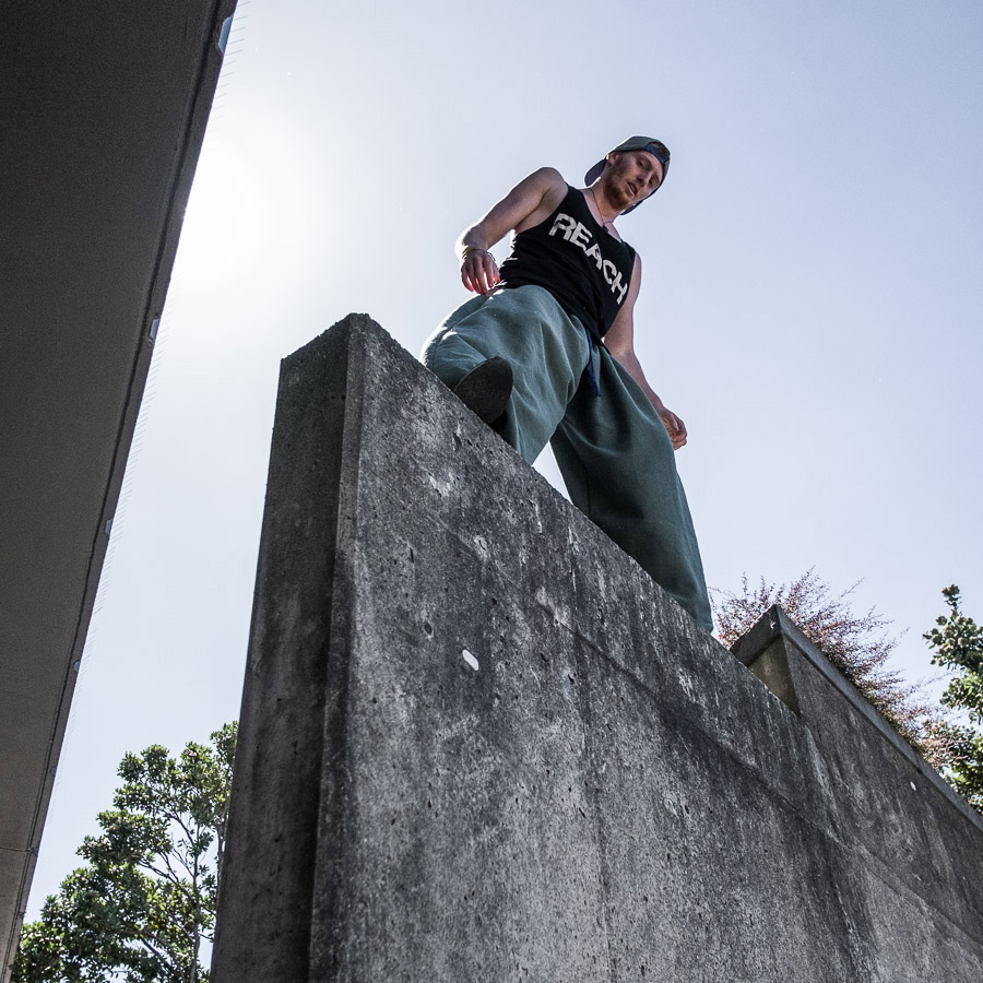 Candid portrait of parkour traceur taken in Wellington, New Zealand