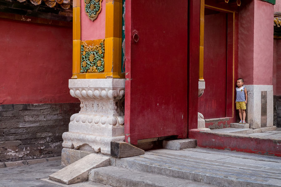 Color photo of young boy in the Forbidden City, Beijing, China