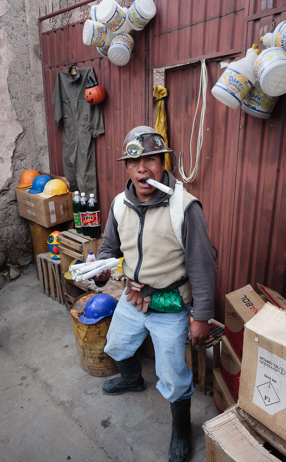 A miner with dynamite and coca leaves in Potosi, Bolivia photographed with a wide-angle lens