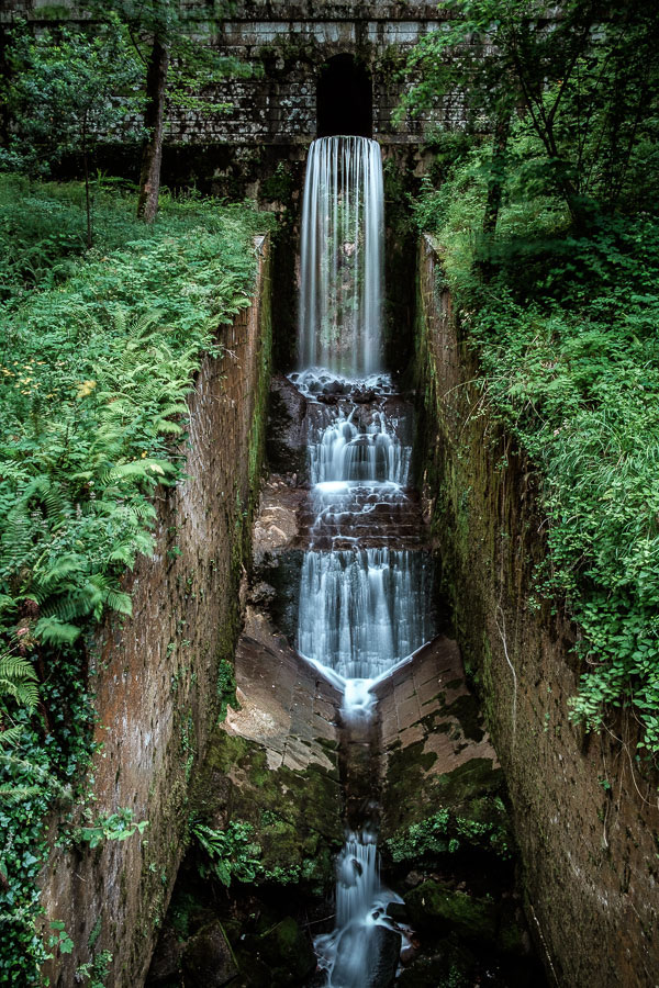 A landscape photo of a waterfall in Covedonga, Spain made with shutter priority